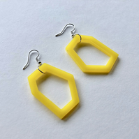 Contemporary geometric acrylic earrings in bright yellow.