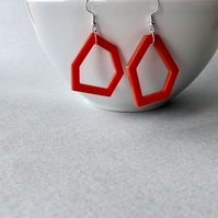 Modern minimalist red acrylic geometric earrings.
