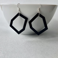 Black geometric acrylic pendant earrings.