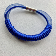 Blue cord and mesh bangle.