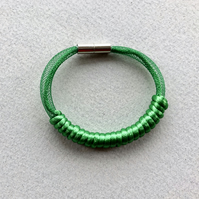 Emerald green cord and mesh bangle.