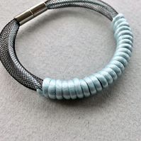Aqua blue and black cord bangle with magnetic clasp.