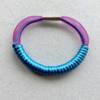 Turquoise and purple cord wrapped bracelet with magnetic clasp.