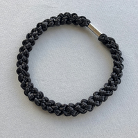 Black hand knotted cord rope necklace with magnetic clasp.