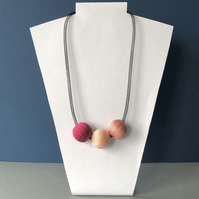 Contemporary three bead pink necklace.