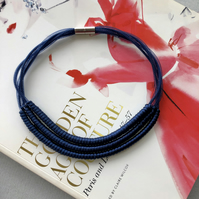 Navy blue contemporary three strand cord necklace.