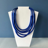 Statement blue five strand cord necklace.
