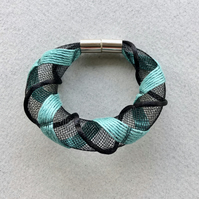 Black and sea green hand embroidered tubular bangle.