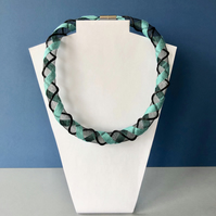 Sea green and black embroidered collar necklace.