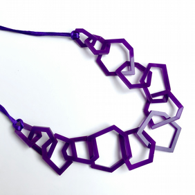 Statement purple acrylic contemporary necklace.