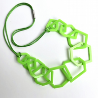 Lime green geometric acrylic contemporary necklace.