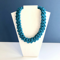 Hand knotted turquoise cotton collar necklace.