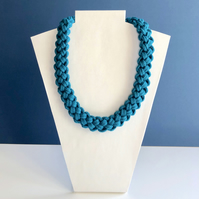 Modern turquoise hand knotted cotton cord necklace.