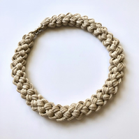 Contemporary cream cotton hand knotted collar necklace.