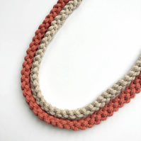 Terra cotta and cream two strand knotted cotton necklace.