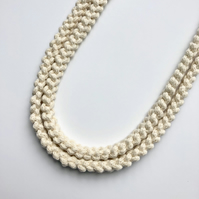 Cream hand knotted cotton rope necklace.