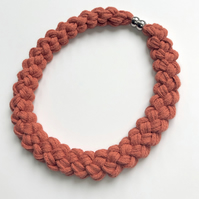 Terra cotta hand knotted collar necklace.
