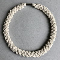 Pale cream knotted cotton rope necklace.