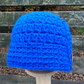 Crocheted Baby Hat: Royal Blue Yarn and Tan Button