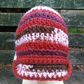 Crocheted Child's Hat: Mix Red with Rose and Rose Brooch.