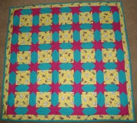 'Bring on the clowns' Cot Quilt, play mat or picnic blanket