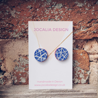 Hand painted blue and white leather stud earrings