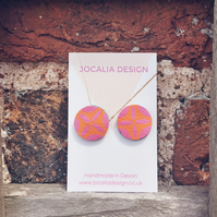Hand painted orange and pink leather stud earrings