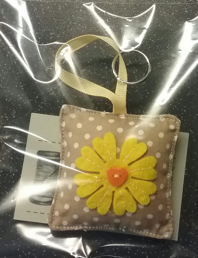 Square key ring with flower