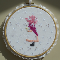 Hoop embroidery of a girl in pink