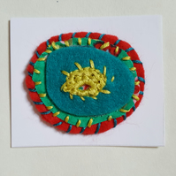 Hand stitched magnet