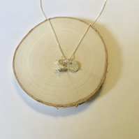 Sterling silver pheasant hand hammered disc necklace