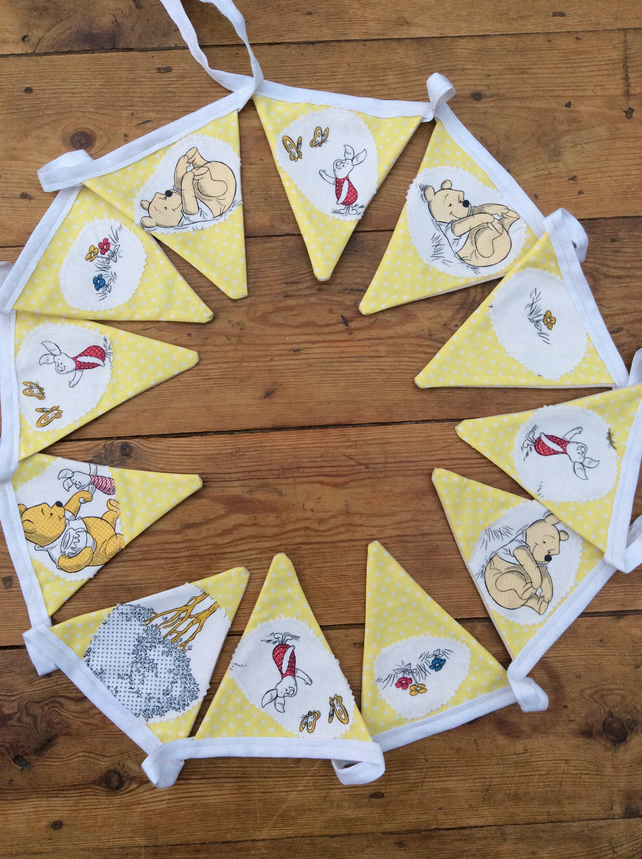Bunting. Winnie the Pooh fabric appliqué on yellow dotty fabric. 12 Flags.