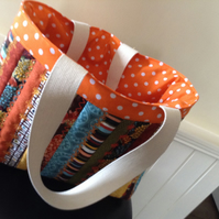 Small jelly roll bag with embroidery. Autumnal colours