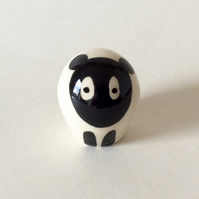Little handmade pottery sheep.