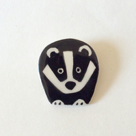 Ceramic badger brooch.