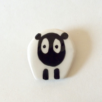 Ceramic sheep brooch.
