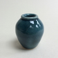 Small dark blue handmade pot.