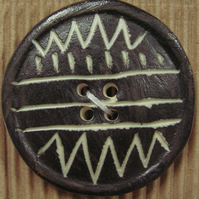 Two ceramic black and white zig zag circle buttons