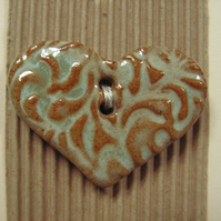 Ceramic brown and turquoise heart button