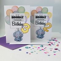 Cute elephant holding balloons. Children's age Birthday card