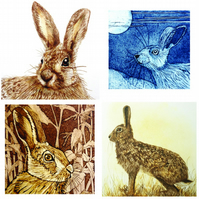 Set of four hare greetings cards.