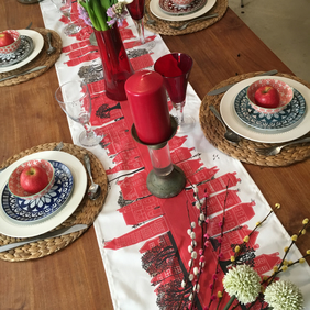 Red urban design table runner from MollyMac. Contemporary quality table linen