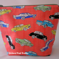 Waterproof zipped wash bag - vintage cars on a red background