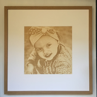 engraved photo in a frame