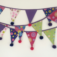 Funky bunting with woollen pom poms in bright pink, blue, lime and purple