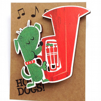 Tuba dog brooch