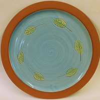 Turquoise plate with leaf decoration