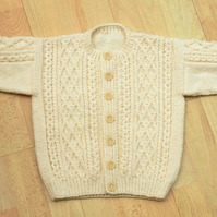 hand knitted cream aran style cardigan to fit 56cm chest age 2 to 3