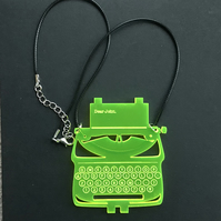 Typewriter necklace in green fluorescent acrylic