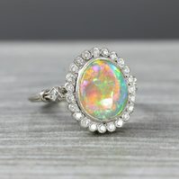 Opal and diamond halo ring in 18 carat white gold